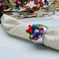 Set Of Four Kitsch Christmas Wreath Napkin Rings