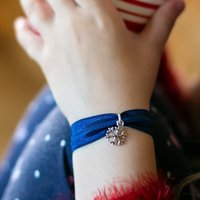 A Stretchy Snowflake Charm Bracelet For Christmas