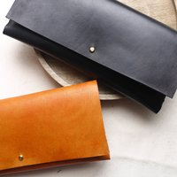 Leather Clutch Bag With Interlocking Seam