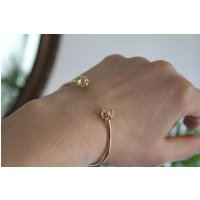 Nine Carat Gold Infinity Cuff Bangle, Gold