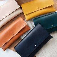 Leather Clutch Bag With Interlocking Seam