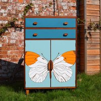 Mid Century Tallboy With Formica Butterfly Design