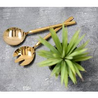A Set Of Gold Salad Servers In A Presentation Box