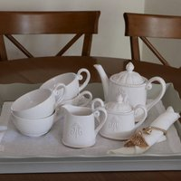Ivory Ceramic Tea Set With Embossed Emblem