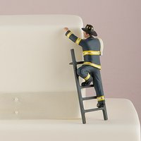 \To the Rescue!\ Fireman Groom Figurine