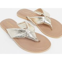 Accessorize leather knotted flip flops in rose gold