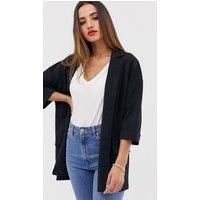 ASOS DESIGN easy relaxed blazer in textured jersey-Black