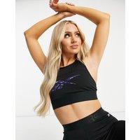 Reebok Training longline bra in black with leopard logo