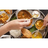 TwoCourse Indian Meal, Side and Drink for Two or Four at Pooja's Street Side Indian Vegetarian