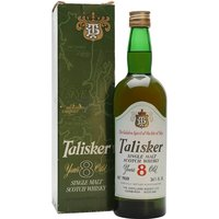 75cl / 45.8% / Distillery Bottling - A bottle of 8 year old Talisker.  Dating from the 1970s, the same decade the maltings at the distillery closed and barley began to be imported from Glen Ord (the nearest maltings 100 miles away).  Beautifully presented in a green box to match the glass.
