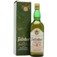 75cl / 45.8% / Distillery Bottling - A bottle of 8 year old Talisker. which we estimate dates from the 1970s.  This was the same decade the maltings at the distillery closed and barley began to be imported from Glen Ord (the nearest maltings 100 miles away).  Beautifully presented in a green box to match the glass.