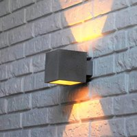 Proof   a wall light with a concrete lampshade