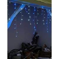 Product photograph showing Festive Set Of 960 Blue And White Led Snowing Icicle Lights