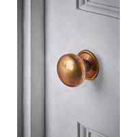Product photograph showing Cox Cox Round Door Knob - Antique Brass