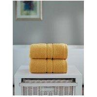 Product photograph showing The Lyndon Co Chelsea Super Soft 600 Gsm Zero Twist Bath Towel - Mustard