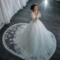 High-end Transparent Long Sleeve Lace Beaded Ball Gown Wedding Dress