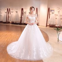 Guangzhou new designs O-Neck Backless wedding dress with long tail