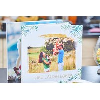 £11.49 (from Colorland) for a 32 page 30 x 30cm photo book, £14.49 for a 48 page photo book or £17.49 for a 72 page photo book