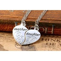 £8 instead of £22.99 for a pair of mother and daughter pendants from GetGorgeous - save 65% - Daughter Gifts