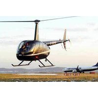 £99 for a 10-minute private helicopter flight for two including a glass of Prosecco each, chocolates and a rose at Helicentre Manchester - Chocolates Gifts