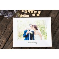 £15 (from Huggler) for a 100-page personalised photo book - Photo Gifts