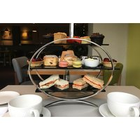 £19 for a classic afternoon tea for two people, or £25 to include a glass of gin and tonic each at Novotel York Centre - People Gifts