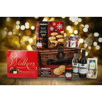 a Christmas wicker hamper including wine, Christmas pudding fudge, shortbread, mince pies, chocolate and more from First4Hamper  save 52%