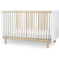 Product photograph showing Oeuf Rhea Cot Bed In White Birch