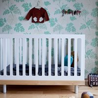 Product photograph showing Oeuf Classic Cot Bed In White Birch