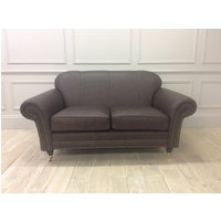 Product photograph showing Chelsea 2 Seater Sofa In Dune Coffee Leather With Studding And Castors
