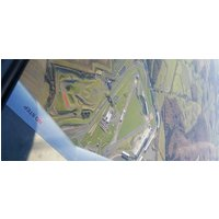 Click to view details and reviews for Silverstone Circuit Scenic Flying Lesson.