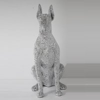 Product photograph showing Sitting Dog Sculpture In Silver Finish