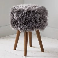 Product photograph showing Bovril Sheepskin Stool In Grey With Solid Oak Legs
