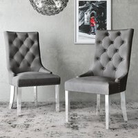 Product photograph showing Donatello Silver Grey Velvet Fabric Dining Chairs In Pair