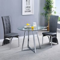 Product photograph showing Melito Clear Round Dining Table With 2 Ravenna Grey Chairs