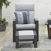 Product photograph showing Mintly Reclining Armchair With Footstool In Carbon Black