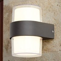 Product photograph showing Naos Round Led Outdoor Up Down Wall Light In Black Clear Glass