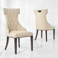 Product photograph showing Tybrook Cream Faux Leather Dining Chair With Wood Legs In A Pair