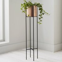 Product photograph showing Vail Large Metal Stilts Plant Holder In Black And Copper