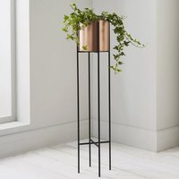 Product photograph showing Vail Small Metal Stilts Plant Holder In Black And Copper