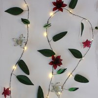 Click to view product details and reviews for Clematis Metal Floral Fairy Lights.