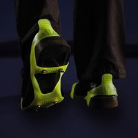Click to view product details and reviews for Glow In The Dark Ice Traction Slip Ons.