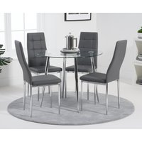 Product photograph showing Cassa 90cm Round Dining Table With Cassa Pu Dining Chairs