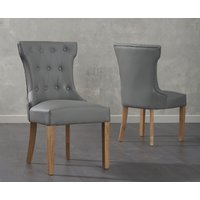 Product photograph showing Cora Grey Faux Leather Dining Chairs Pairs