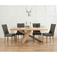 Product photograph showing Chateau 180cm Oak And Metal Dining Table With Charcoal Grey Anais Fabric Chairs
