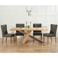 Product photograph showing Chateau 180cm Oak And Metal Dining Table With Safia Fabric Chairs