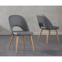 Product photograph showing Harrogate Grey Faux Leather Dining Chairs Pairs