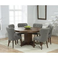 Product photograph showing Ex-display Torino 150cm Dark Solid Oak Round Pedestal Dining Table With 6 Grey Knightsbridge Fabric Dark Oak Leg Chairs