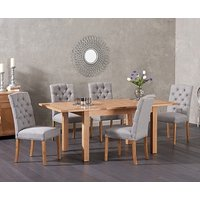 Product photograph showing Ex-display Cheadle 130cm Oak Extending Dining Table With 4 Grey Claudia Chairs