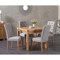 Product photograph showing Ex-display Cheadle 90cm Oak Extending Dining Table With 4 Cream Claudia Chairs